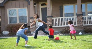 mother-and-children-running-and-playing-in-front-yard-2