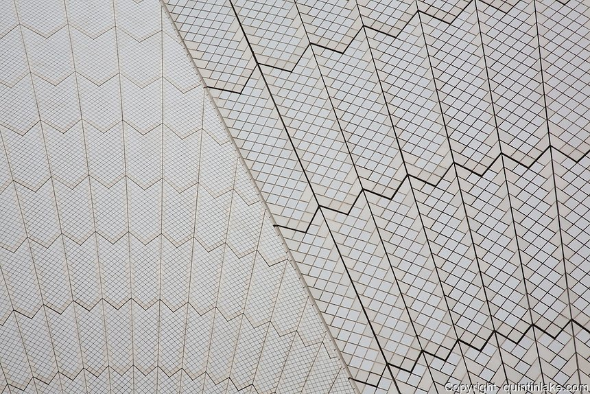 """The roof is constructed of a series of precast concrete """"shells"""". The roofs of the Sydney Opera House are covered in a subtle chevron pattern with 1,056,006 glossy white- and matte-cream-colored Swedish-made glazed ceramic  tiles from HšganŠs AB though, from a distance, the shells appear a uniform white. Architect: J¿rn Utzon. Structural engineer: Ove Arup & Partners. Completed: 1973. UNESCO World Heritage Site 2007"""